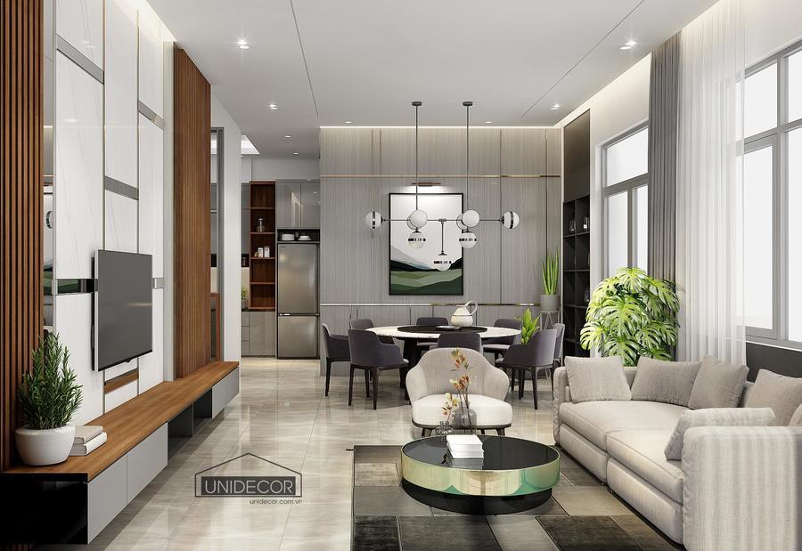 Phòng khách và phòng bếp liền kề, nhìn không gian rộng rãi hơn nhưng không kém phần sang trọng