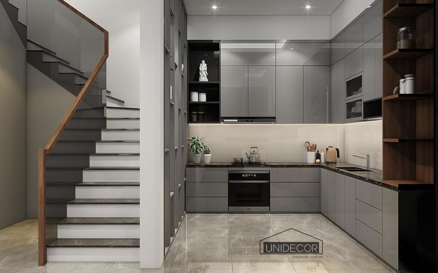 lối đi cầu thang lên tầng trên được che bởi vách ngăn với phòng bếp