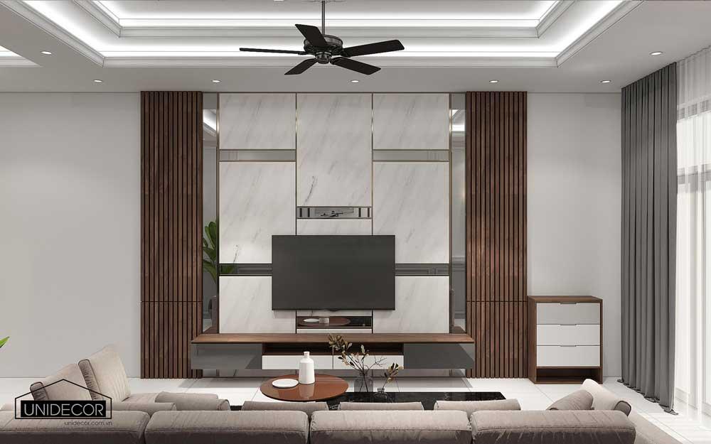 Trang trí kệ tivi phòng khách với các thanh lam gỗ 2 bên làm điểm nhấn