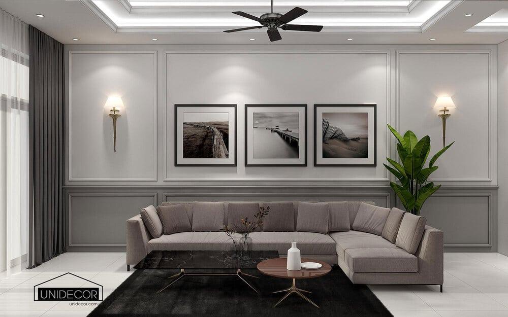 Bộ sofa phòng khách sang trọng được nhấn bởi các bức tranh treo tường